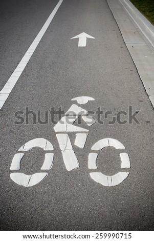 A bike lane or bikeway symbol on asphalt roadway - stock photo