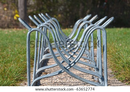 A bike rack for holding bikes without any bikes - stock photo