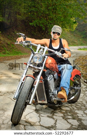A biker on a chopper - stock photo