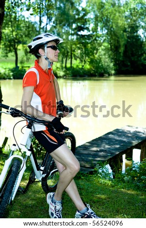 a biking woman in front of nature scenes