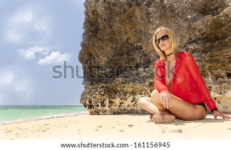 A bikini model posing in an outdoor environment  - stock photo