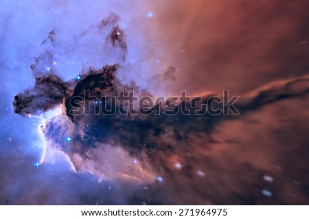 A billowing tower of gas and dust rises from the stellar nursery known as the Eagle Nebula. Space with stars, nebula and galaxy. Image with small DOF. Elements of this image furnished by NASA. - stock photo