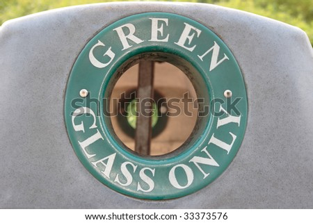 a bin for recycling green glass only - stock photo