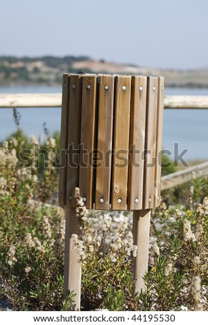 a bin in an ecological reserve for caring for the environment