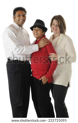 A biracial family of three -- an Asian Indian dad, caucasian mom and their handsome preteen son.  On a white background. - stock photo
