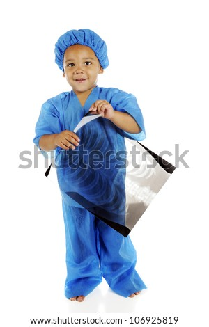 "A biracial preschool ""doctor"" in blue scrubs, happily holding a chest x-ray.  On a white background."