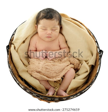 A bird's eye view of a newborn sleeping in a round basket.  On a white background. - stock photo