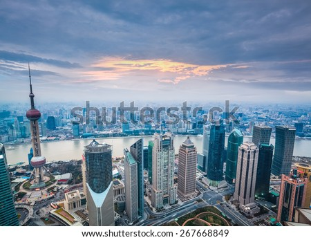 a bird's eye view of shanghai at dusk, charming modern city - stock photo