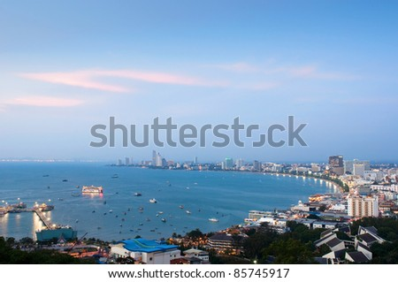 A bird's view over the beach of Pattaya city in Chonburi, Thailand just after sunset with a deep blue sky. - stock photo