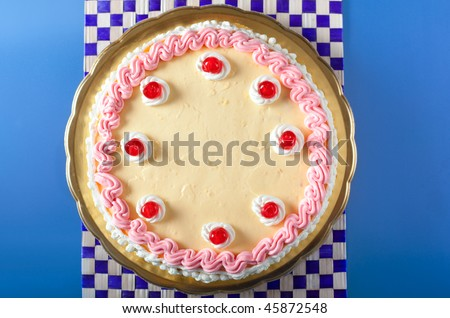 A birthday cake with strawberry and lemon cream with cherries on top - stock photo