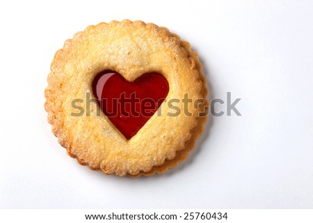 a biscuit with jam in the shape of a heart on a white background - stock photo