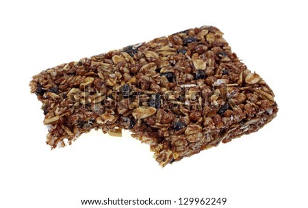 A bite of a chewy granola bar on white. - stock photo