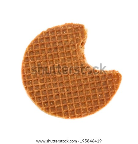 A bite of the typical Dutch stroopwafel (Caramel waffle). Isolated on white. - stock photo