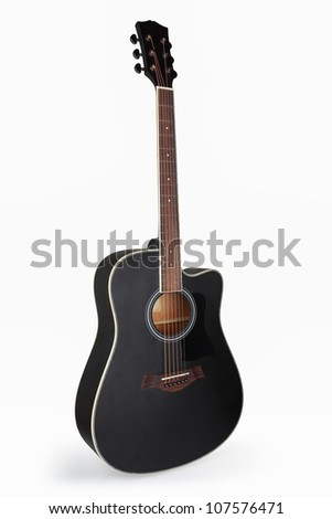 a black acoustic guitar isolated on the white - stock photo