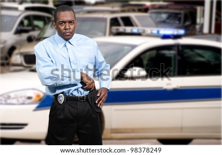 A black African American police detective man on the job with a gun - stock photo