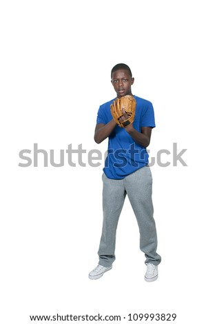 A black African American teenage man baseball pitcher getting ready to throw a ball in a game - stock photo