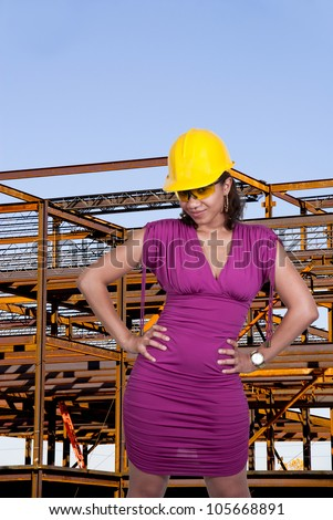 A black African American Woman Construction Worker wearing a hard hat and safety glasses