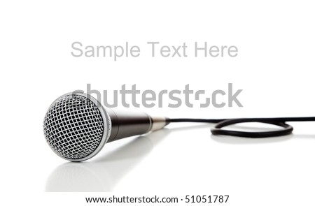 A black and silver microphone on a white background with copy space - stock photo