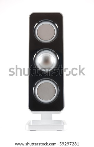 A black and silver modern speaker straight on against a white isolated background. - stock photo