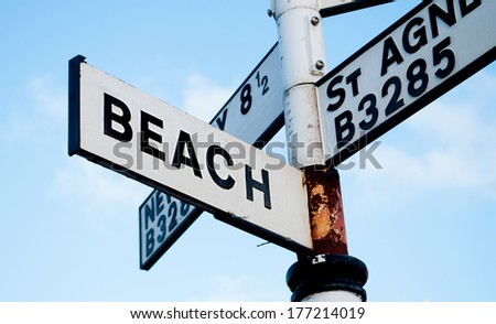 A black and white beach sign in Cornwall, UK. - stock photo