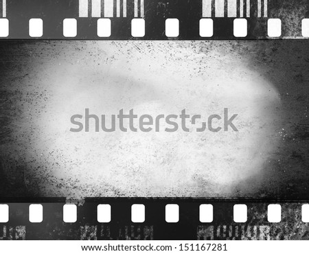 A black and white grunge film frame with white empty space inside - stock photo