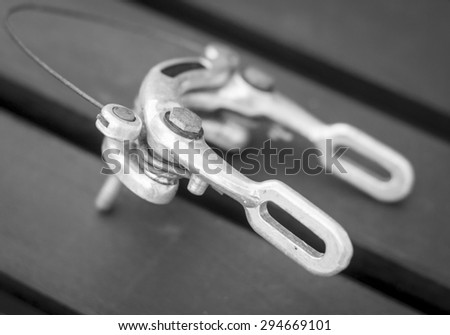 A black and white image of a bicycle caliper brake - stock photo