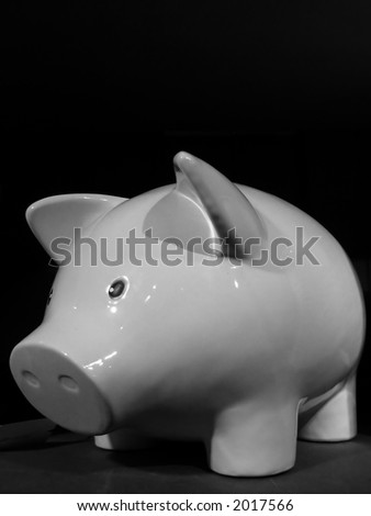 A black and white image of an adorable porcelain piggybank.
