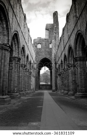 A black and white image of Kirkstall Abbey in Leeds, UK - stock photo