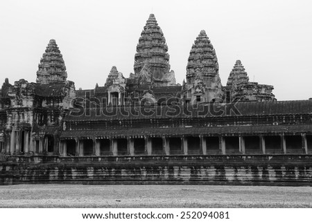 a black and white image of the unmistakable ruins of Angkor Wat near Siem Reap Cambodia. - stock photo