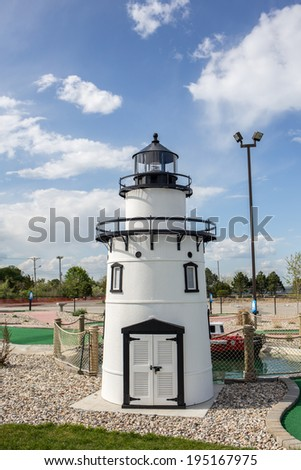 A black and white scale lighthouse at the Old Saybrook, CT pier miniature golf course. - stock photo