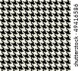 A black and white seamless hounds tooth pattern or texture with lots of detail. - stock photo