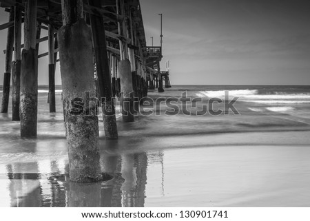 A black and white shot looking out from Balboa Pier in Newport Beach. - stock photo