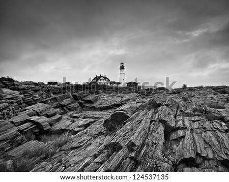 A black and white shot of a lighthouse in Martha's Vineyard. - stock photo