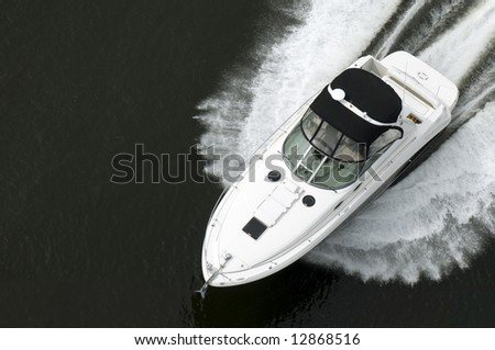 A black and white speedboat shot from above while travelling fast. - stock photo