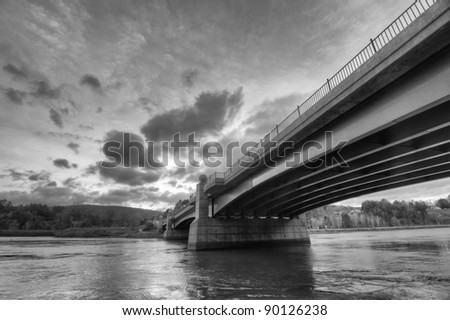 A Black and White View from Underneath a Bridge - stock photo