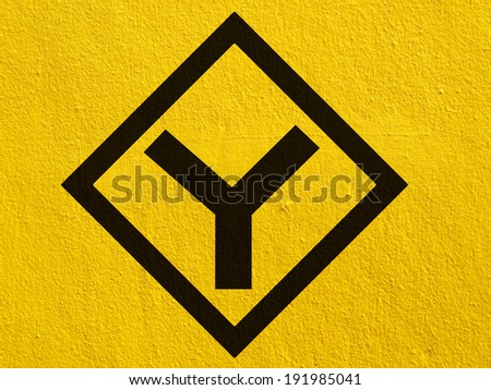 a black arrow points painted on a stucco wall outside - stock photo
