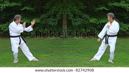 A Black Belt Martial artist facing his worst fear of himself outside with room for your text - stock photo