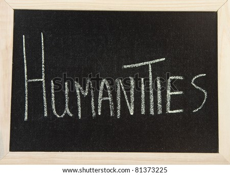 A black board with a wooden frame and the words 'HUMANITIES' written in chalk.