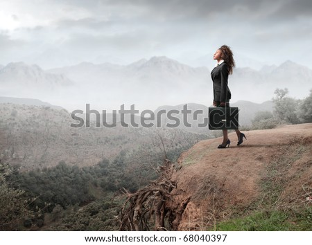 A black businesswoman is looking up to the nature - stock photo