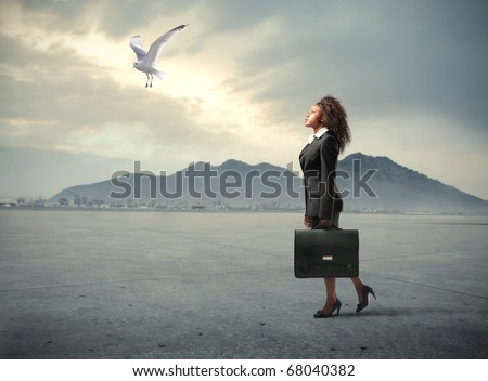A black businesswoman is looking up to the sky - stock photo