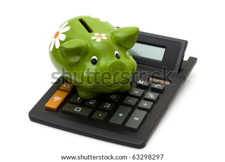 A black calculator with a piggy bank isolated on a white background, Calculating your savings - stock photo