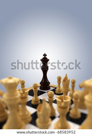 A black chess king is pushed into the corner by all white chess pieces - stock photo