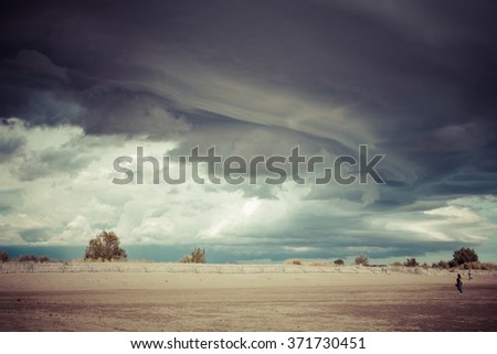 A black cloud on a beach with pastel tone