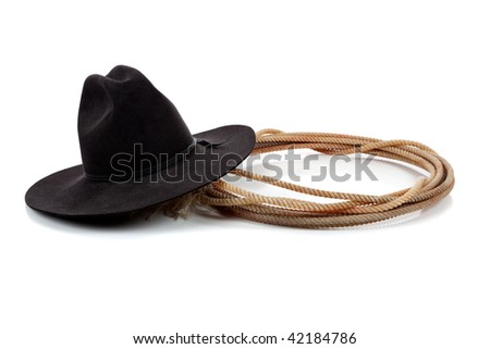 A Black cowboy hat and lasso on a white background with copy space - stock photo