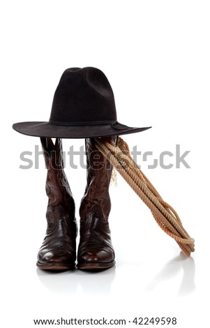 A black cowboy hat, boots and lasso on a white background - stock photo