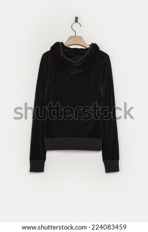A black empty hoody shirts front side with wooden hanger isolated white background. - stock photo