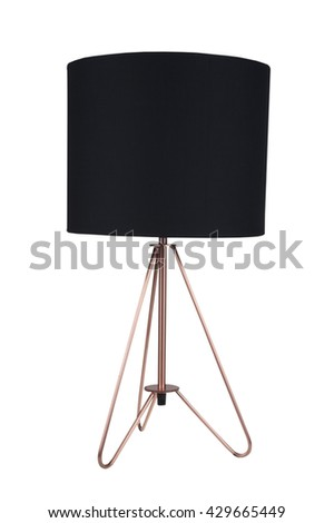 A black fabric and copper tripod table lamp isolated on a white background - stock photo