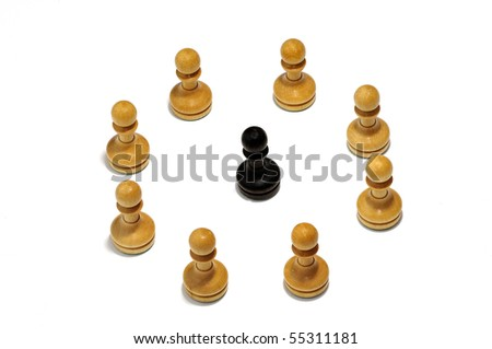 A black figure in the middle of a circle of white figures - stock photo