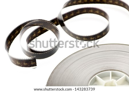 A black film reel isolated on white