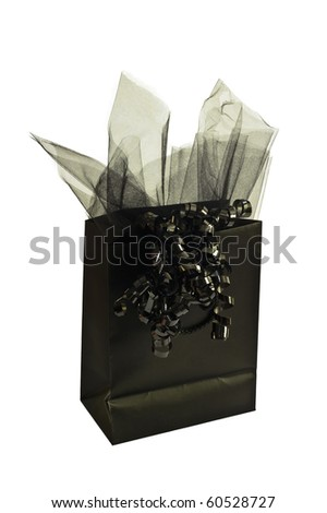 A Black gift bag with black netting and ribbon isolated on a white background can be used for Halloween.